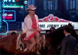Bill Murray arrives horseback in a dress