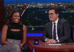 Michelle Obama does impression of her husband / President for Stephen Colbert